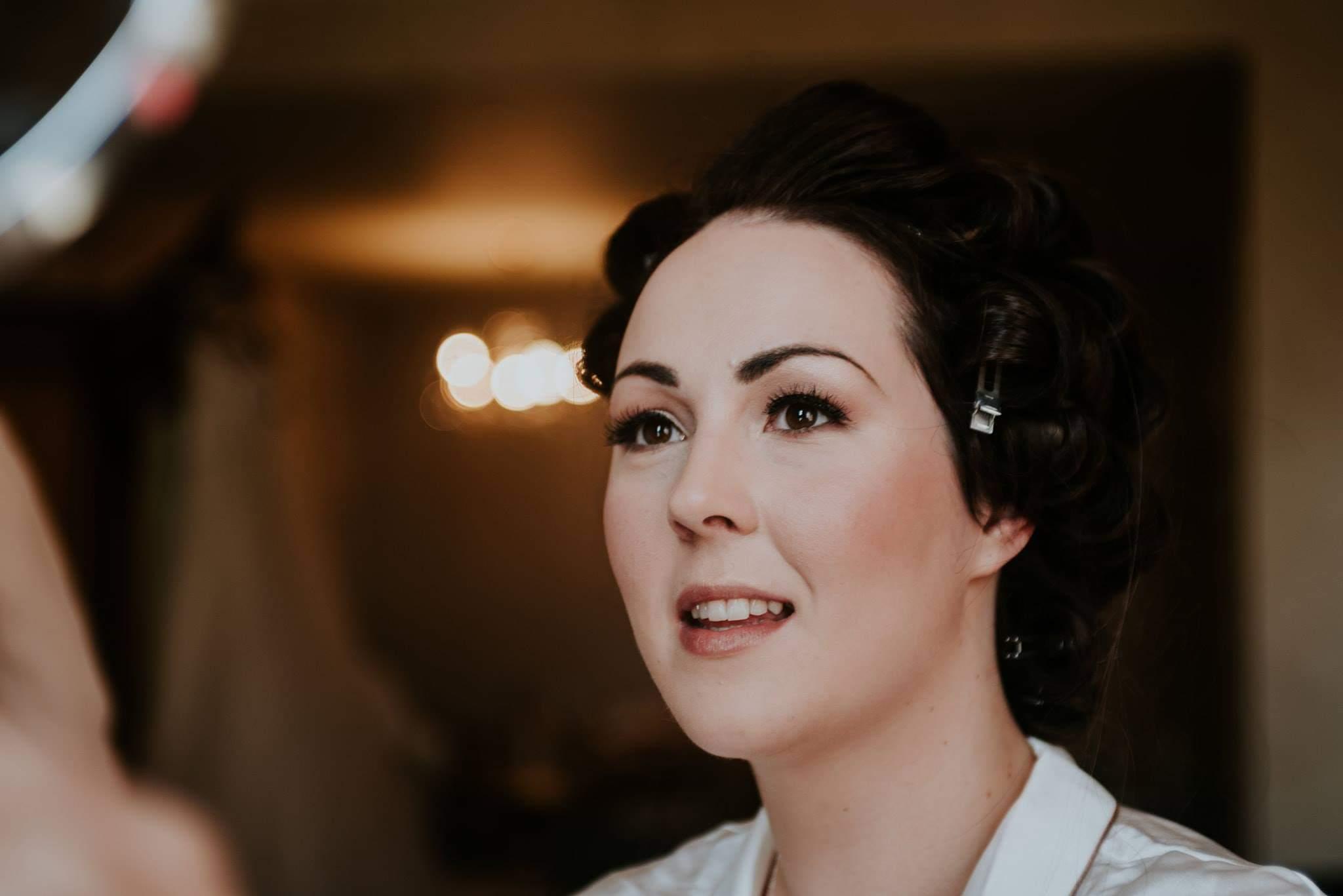 bride looking at her wedding makeup at 30 James Street Hotel Liverpool