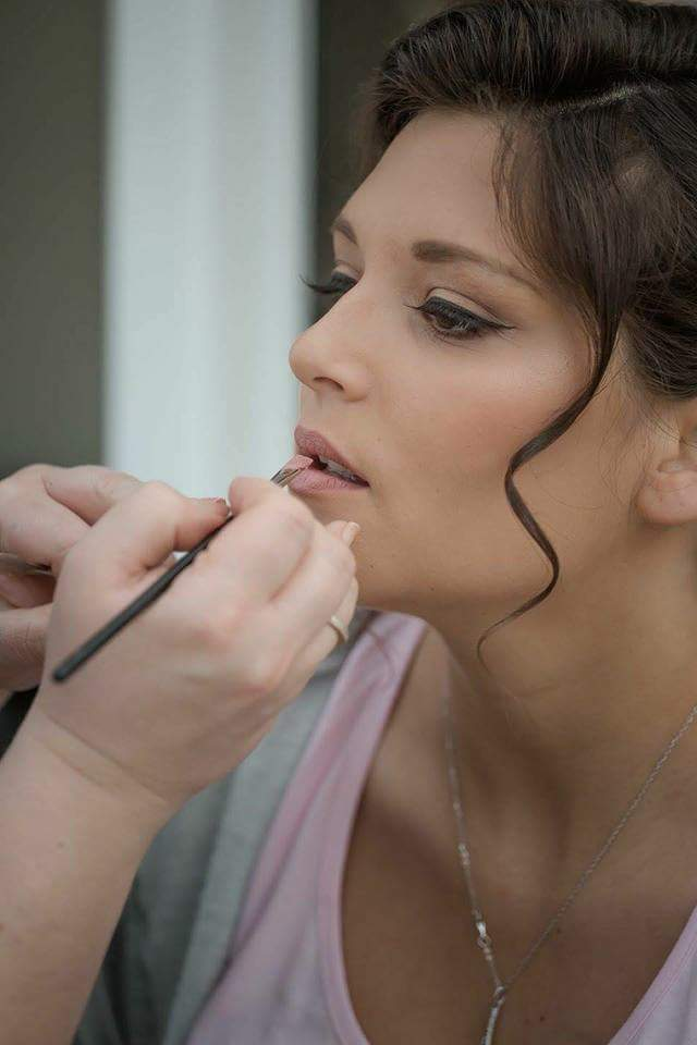 bridesmaid having her lipstick applied by Glamorama Makeup Liverpool