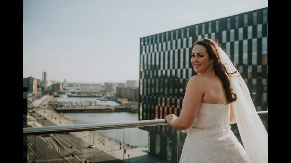 Bride looking at Liverpool from 30 James Street hotel