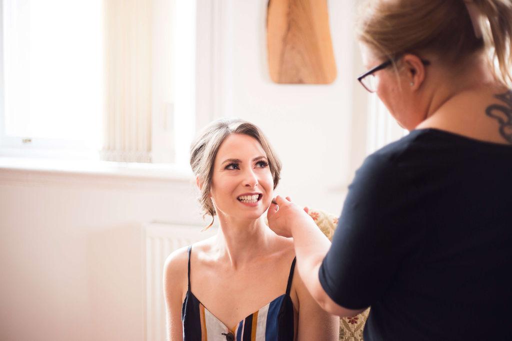 bride having wedding makeup done in Liverpool
