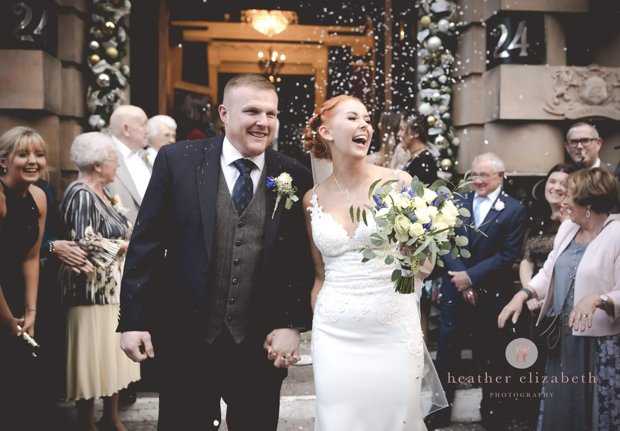 bride and groom walking through confetti  at The Richmond Hotel Liverpool