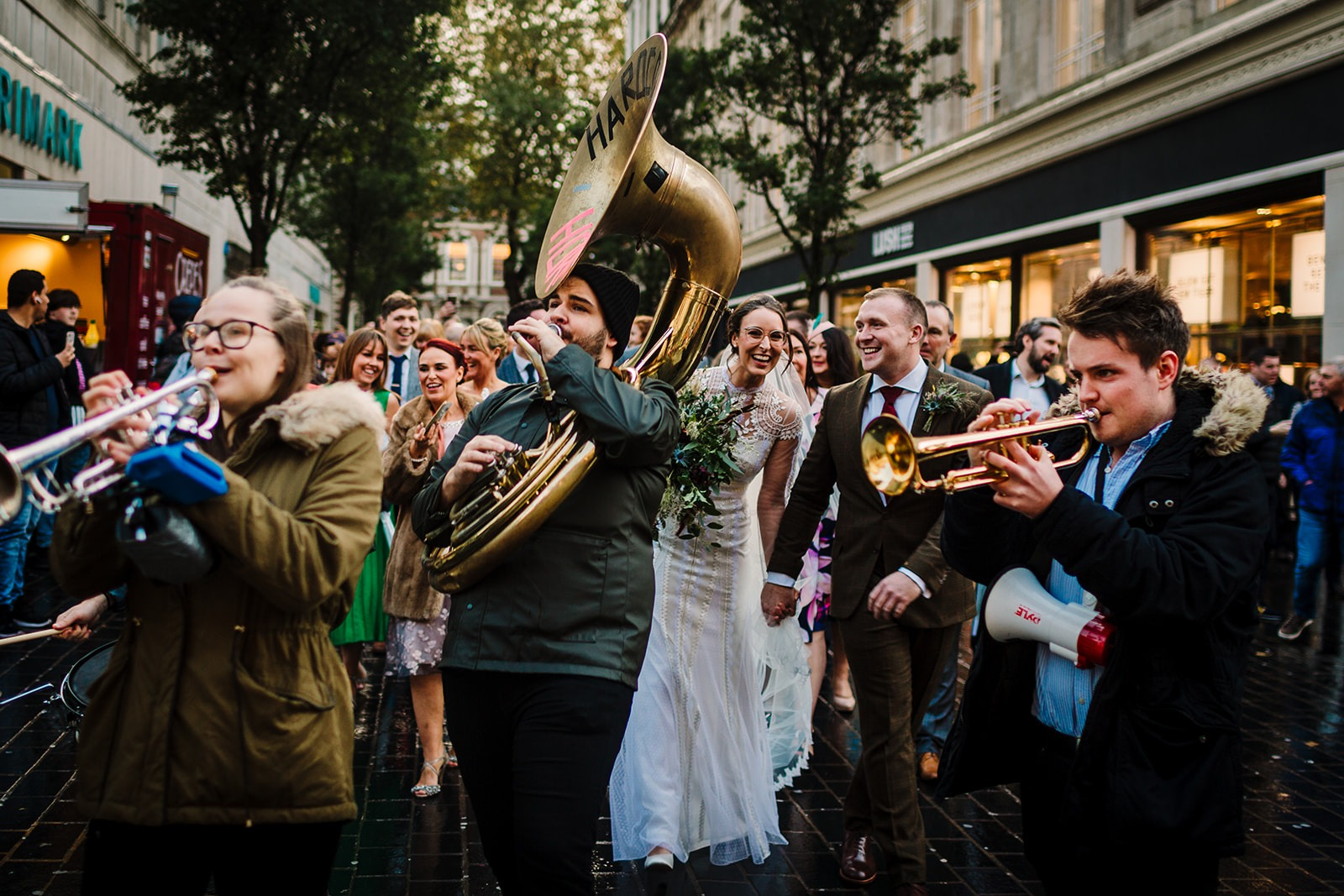 Bride and groom with brass band in Liverpool City Center