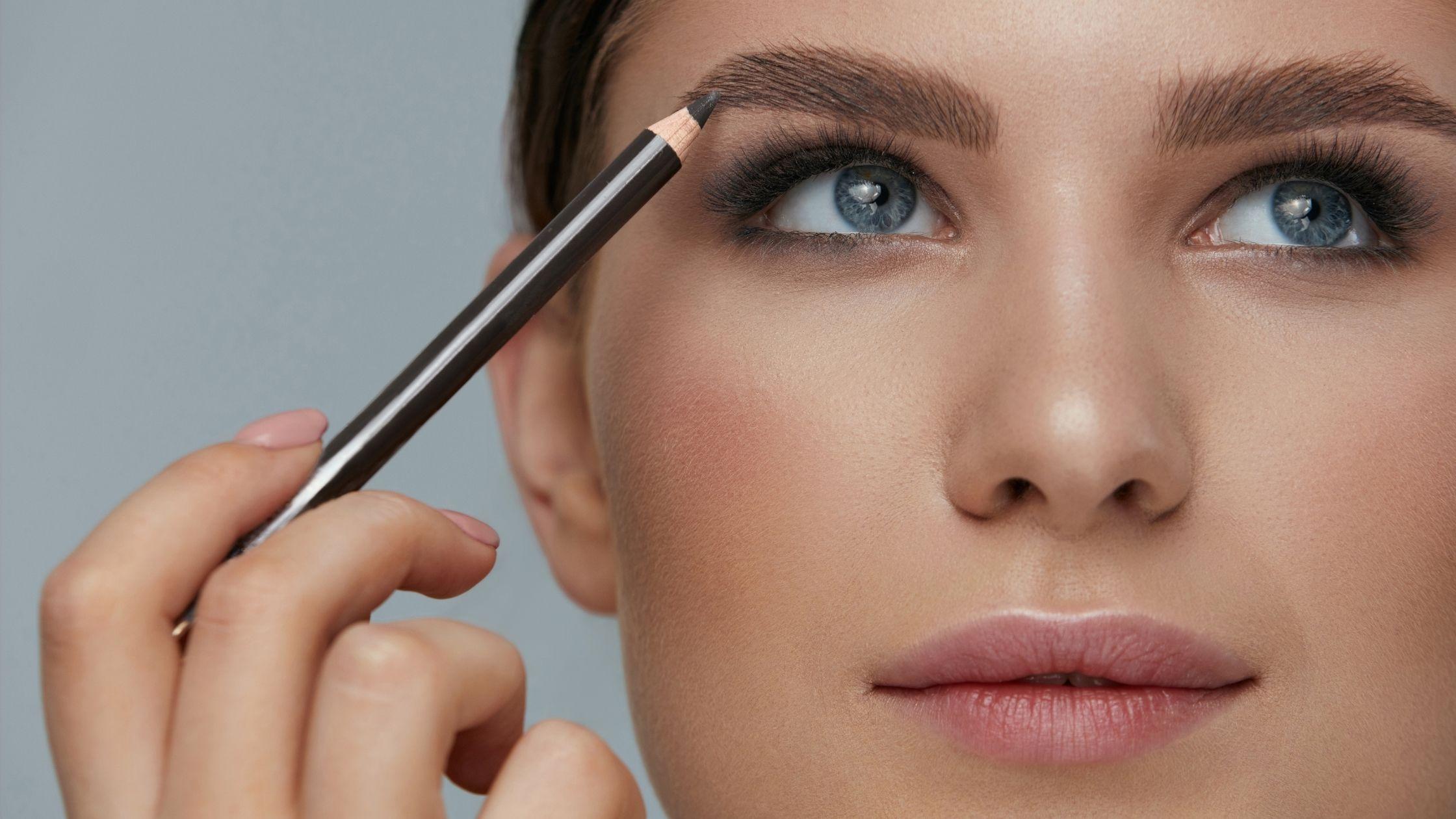 woman using an eyebrow pencil